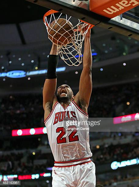 Taj Gibson of the Chicago Bulls lets out a scream as he dunks against the New Orleans Pelicans at the United Center on December 2 2013 in Chicago...