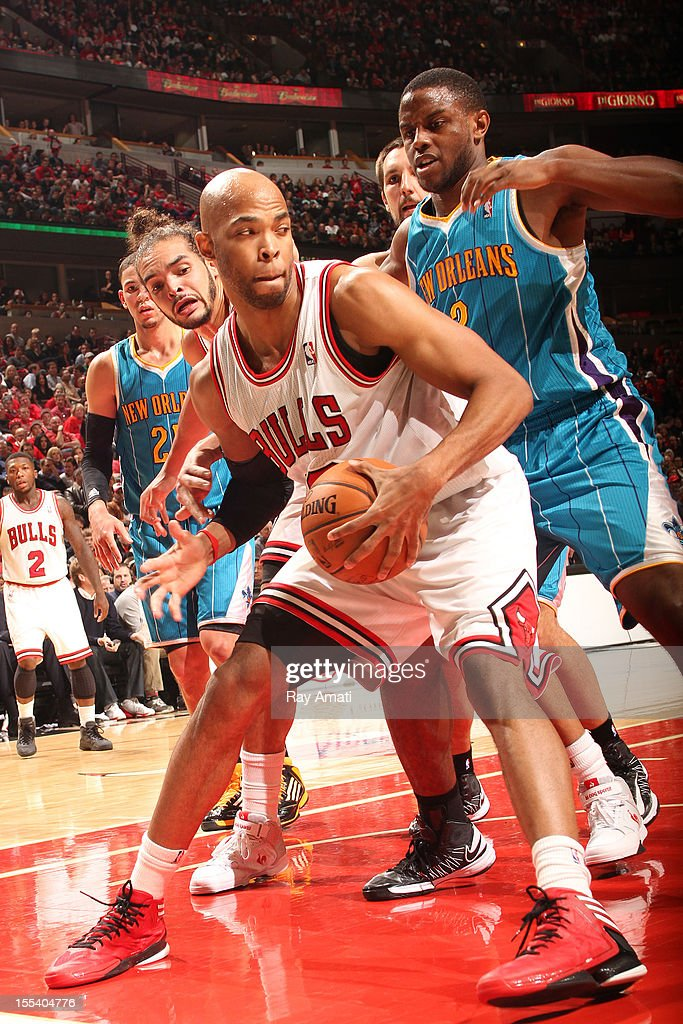 <a gi-track='captionPersonalityLinkClicked' href=/galleries/search?phrase=Taj+Gibson&family=editorial&specificpeople=4029461 ng-click='$event.stopPropagation()'>Taj Gibson</a> #22 of the Chicago Bulls looks to pass while guarded by <a gi-track='captionPersonalityLinkClicked' href=/galleries/search?phrase=Darius+Miller&family=editorial&specificpeople=5590631 ng-click='$event.stopPropagation()'>Darius Miller</a> #2 of the New Orleans Hornets on November 3, 2012 at the United Center in Chicago, Illinois.