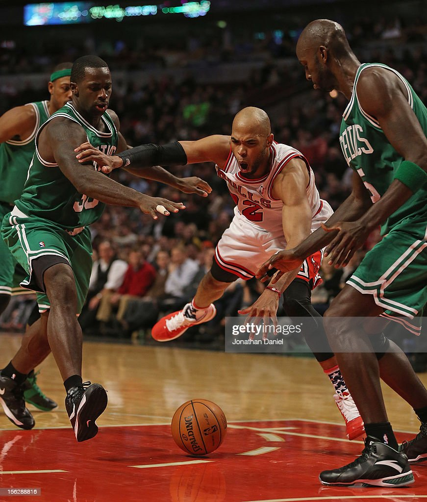 Taj Gibson #22 of the Chicago Bulls looses control of the ball between Brandon Bass #30 (L) and Kevin Garnett #5 of the Boston Celtics at the United Center on November 12, 2012 in Chicago, Illinois. The Celtics defeated the Bulls 101-95.