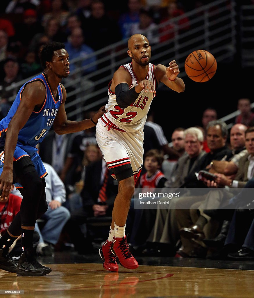 Taj Gibson #22 of the Chicago Bulls passes under pressure from Hasheem Thabeet #34 of the Oklahoma City Thunder at the United Center on November 8, 2012 in Chicago, Illinois. The Thunder defeated the Bulls 97-91.