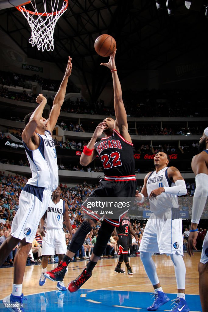 <a gi-track='captionPersonalityLinkClicked' href=/galleries/search?phrase=Taj+Gibson&family=editorial&specificpeople=4029461 ng-click='$event.stopPropagation()'>Taj Gibson</a> #22 of the Chicago Bulls puts up a shot against the Dallas Mavericks on March 30, 2013 at the American Airlines Center in Dallas, Texas.