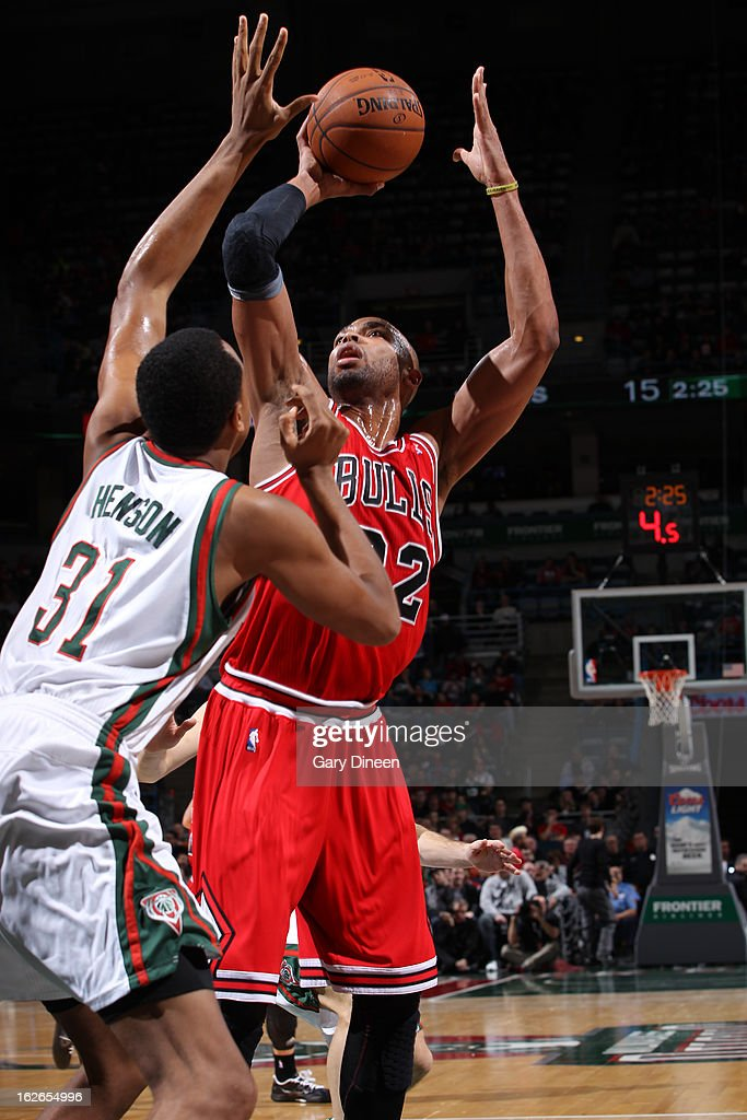 <a gi-track='captionPersonalityLinkClicked' href=/galleries/search?phrase=Taj+Gibson&family=editorial&specificpeople=4029461 ng-click='$event.stopPropagation()'>Taj Gibson</a> #22 of the Chicago Bulls puts up a shot against the Milwaukee Bucks on January 30, 2013 at the BMO Harris Bradley Center in Milwaukee, Wisconsin.