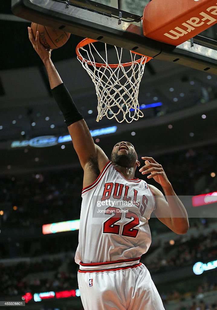 Taj Gibson #22 of the Chicago Bulls puts up a shot against the New Orleans Pelicans at the United Center on December 2, 2013 in Chicago, Illinois. The Pelicans defeated the Bulls 131-128 in triple overtime.