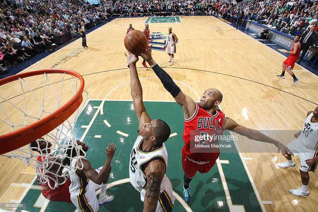 Taj Gibson #22 of the Chicago Bulls reaches for a rebound against Derrick Favors #15 of the Utah Jazz at Energy Solutions Arena on February 08, 2013 in Salt Lake City, Utah.