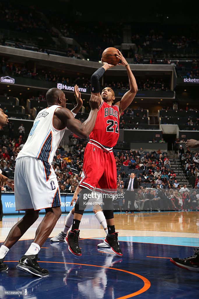<a gi-track='captionPersonalityLinkClicked' href=/galleries/search?phrase=Taj+Gibson&family=editorial&specificpeople=4029461 ng-click='$event.stopPropagation()'>Taj Gibson</a> #22 of the Chicago Bulls shoots against <a gi-track='captionPersonalityLinkClicked' href=/galleries/search?phrase=Bismack+Biyombo&family=editorial&specificpeople=7640443 ng-click='$event.stopPropagation()'>Bismack Biyombo</a> #0 of the Charlotte Bobcats at the Time Warner Cable Arena on February 22, 2013 in Charlotte, North Carolina.