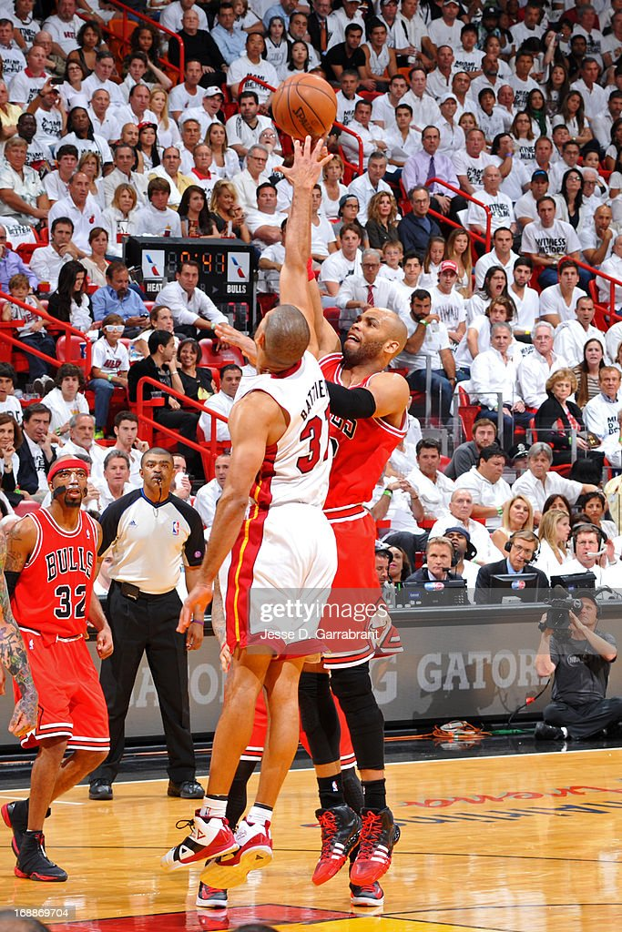 Taj Gibson #22 of the Chicago Bulls shoots against Shane Battier #31 of the Miami Heat in Game Five of the Eastern Conference Semifinals during the 2013 NBA Playoffs on May 15, 2013 at American Airlines Arena in Miami, Florida.