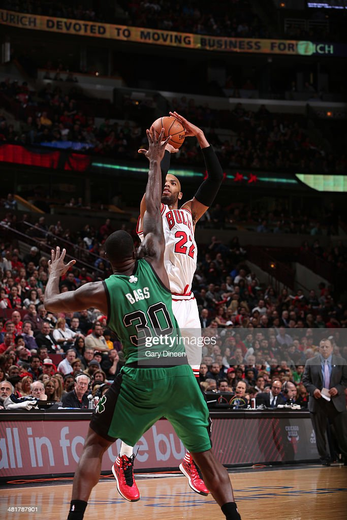 Taj Gibson #22 of the Chicago Bulls shoots against the Boston Celtics on March 31, 2014 at the United Center in Chicago, Illinois.