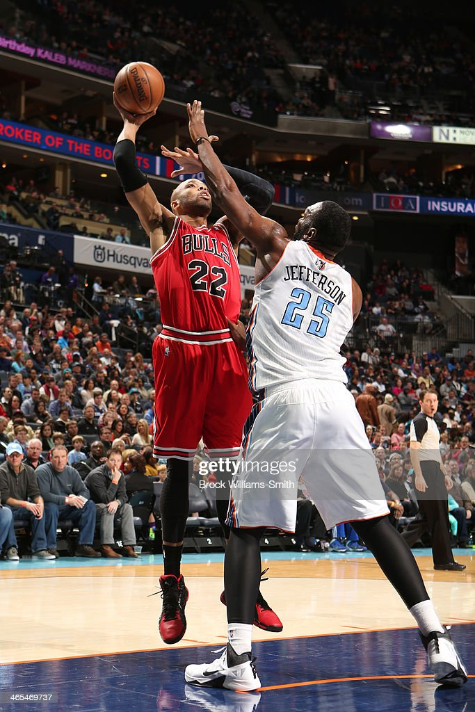 <a gi-track='captionPersonalityLinkClicked' href=/galleries/search?phrase=Taj+Gibson&family=editorial&specificpeople=4029461 ng-click='$event.stopPropagation()'>Taj Gibson</a> #22 of the Chicago Bulls shoots against the Charlotte Bobcats at the Time Warner Cable Arena on January 25, 2014 in Charlotte, North Carolina.