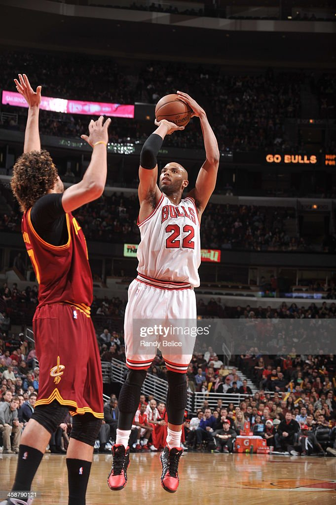 <a gi-track='captionPersonalityLinkClicked' href=/galleries/search?phrase=Taj+Gibson&family=editorial&specificpeople=4029461 ng-click='$event.stopPropagation()'>Taj Gibson</a> #22 of the Chicago Bulls shoots against the Cleveland Cavaliers on December 21, 2013 at the United Center in Chicago, Illinois.