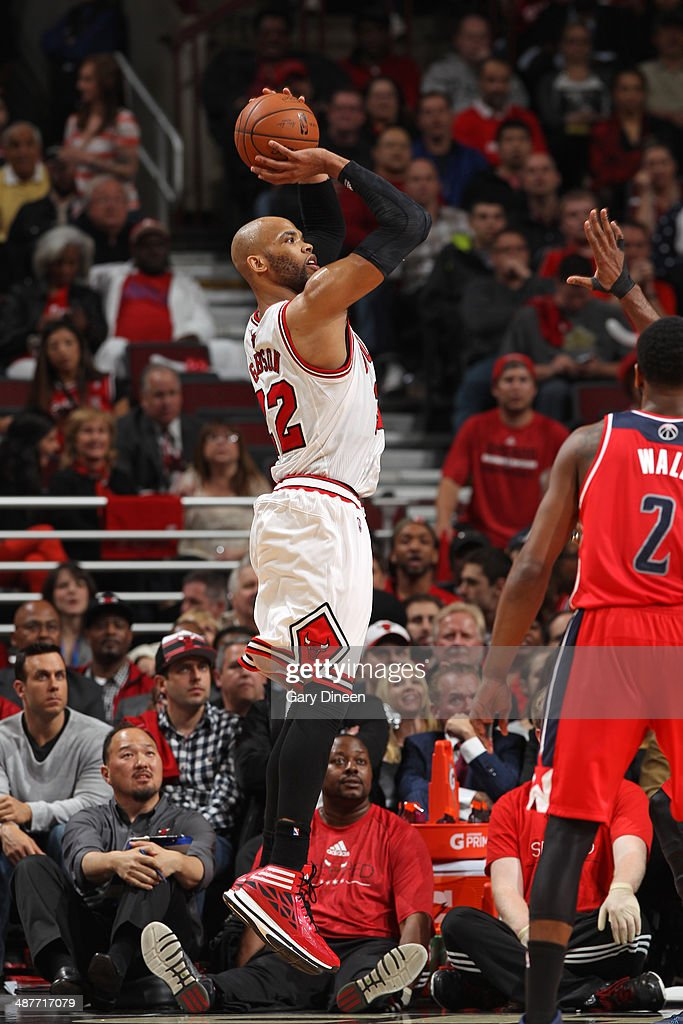 <a gi-track='captionPersonalityLinkClicked' href=/galleries/search?phrase=Taj+Gibson&family=editorial&specificpeople=4029461 ng-click='$event.stopPropagation()'>Taj Gibson</a> #22 of the Chicago Bulls shoots against the Washington Wizards in Game 5 of the Eastern Conference Quarterfinals in the 2014 NBA Playoffs on April 29, 2014 at the United Center in Chicago, Illinois.