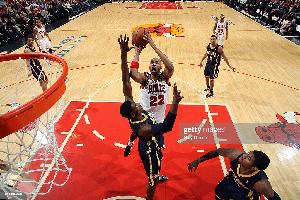 Taj Gibson #22 of the Chicago Bulls shoots over Roy Hibbert #55 of the Indiana Pacers on March 23, 2013 at the United Center in Chicago, Illinois.