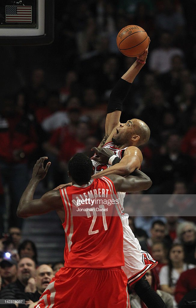 <a gi-track='captionPersonalityLinkClicked' href=/galleries/search?phrase=Taj+Gibson&family=editorial&specificpeople=4029461 ng-click='$event.stopPropagation()'>Taj Gibson</a> #22 of the Chicago Bulls shoots over <a gi-track='captionPersonalityLinkClicked' href=/galleries/search?phrase=Samuel+Dalembert&family=editorial&specificpeople=202026 ng-click='$event.stopPropagation()'>Samuel Dalembert</a> #21 of the Houston Rockets at the United Center on April 2, 2012 in Chicago, Illinois. The Rockets defeated the Bulls 99-93.