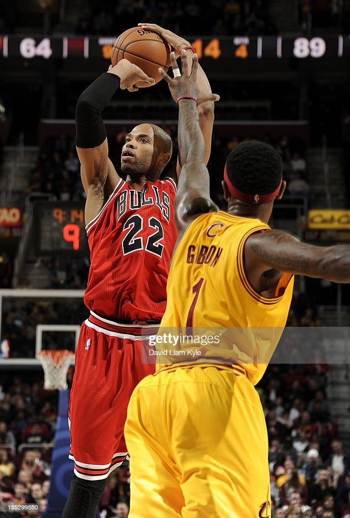 <a gi-track='captionPersonalityLinkClicked' href=/galleries/search?phrase=Taj+Gibson&family=editorial&specificpeople=4029461 ng-click='$event.stopPropagation()'>Taj Gibson</a> #22 of the Chicago Bulls shoots the jumper against <a gi-track='captionPersonalityLinkClicked' href=/galleries/search?phrase=Daniel+Gibson&family=editorial&specificpeople=213906 ng-click='$event.stopPropagation()'>Daniel Gibson</a> #1 of the Cleveland Cavaliers at The Quicken Loans Arena on November 2, 2012 in Cleveland, Ohio.