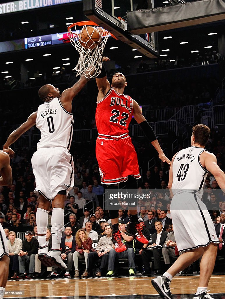 Taj Gibson #22 of the Chicago Bulls sinks a basket on a feed from Nate Robinson #2 in the second quareter against the Brooklyn Nets during Game Five of the Eastern Conference Quarterfinals of the 2013 NBA Playoffs at the Barclays Center on April 29, 2013 in New York City.