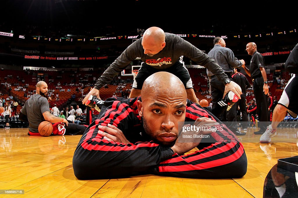 <a gi-track='captionPersonalityLinkClicked' href=/galleries/search?phrase=Taj+Gibson&family=editorial&specificpeople=4029461 ng-click='$event.stopPropagation()'>Taj Gibson</a> #22 of the Chicago Bulls stretches before playing against the Miami Heat in Game Two of the Eastern Conference Semifinals during the 2013 NBA Playoffs on May 8, 2013 at American Airlines Arena in Miami, Florida.