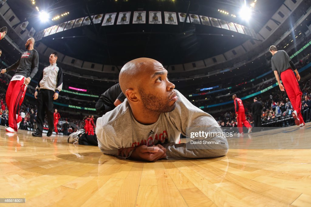 Taj Gibson #22 of the Chicago Bulls stretches before the game against the Minnesota Timberwolves on January 27, 2014 at the United Center in Chicago, Illinois.