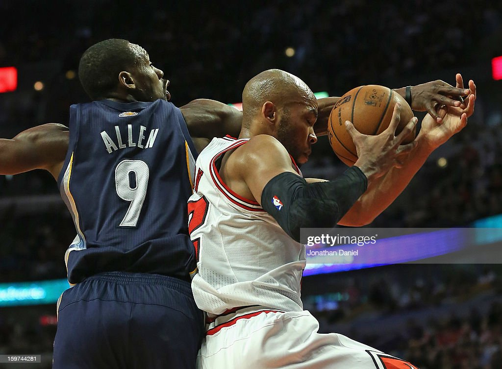 <a gi-track='captionPersonalityLinkClicked' href=/galleries/search?phrase=Taj+Gibson&family=editorial&specificpeople=4029461 ng-click='$event.stopPropagation()'>Taj Gibson</a> #22 of the Chicago Bulls tries to control the ball under pressure from <a gi-track='captionPersonalityLinkClicked' href=/galleries/search?phrase=Tony+Allen&family=editorial&specificpeople=201665 ng-click='$event.stopPropagation()'>Tony Allen</a> #9 of the Memphis Grizzles at the United Center on January 19, 2013 in Chicago, Illinois. The Grizzlies defeated the Bulls 85-82 in overtime.