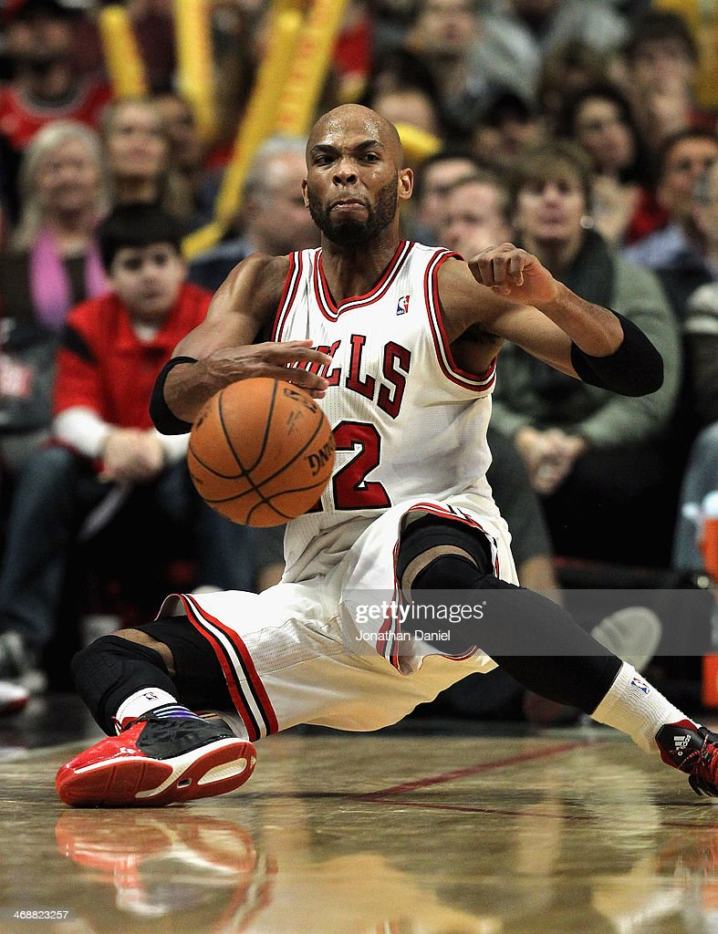 <a gi-track='captionPersonalityLinkClicked' href=/galleries/search?phrase=Taj+Gibson&family=editorial&specificpeople=4029461 ng-click='$event.stopPropagation()'>Taj Gibson</a> #22 of the Chicago Bulls tries to keep the ball from going out of bounds against the Atlanta Hawks at the United Center on February 11, 2014 in Chicago, Illinois. The Bulls defeated the Hawks 100-85.