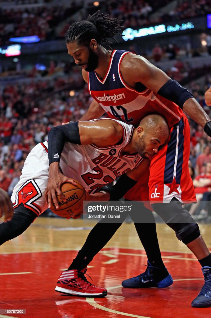 <a gi-track='captionPersonalityLinkClicked' href=/galleries/search?phrase=Taj+Gibson&family=editorial&specificpeople=4029461 ng-click='$event.stopPropagation()'>Taj Gibson</a> #22 of the Chicago Bulls tries to move against Nene #42 of the Washington Wizards in Game One of the Eastern Conference Quarterfinals during the 2014 NBA Playoffs at the United Center on April 20, 2014 in Chicago, Illinois. The Wizards defeated the Bulls 102-93.
