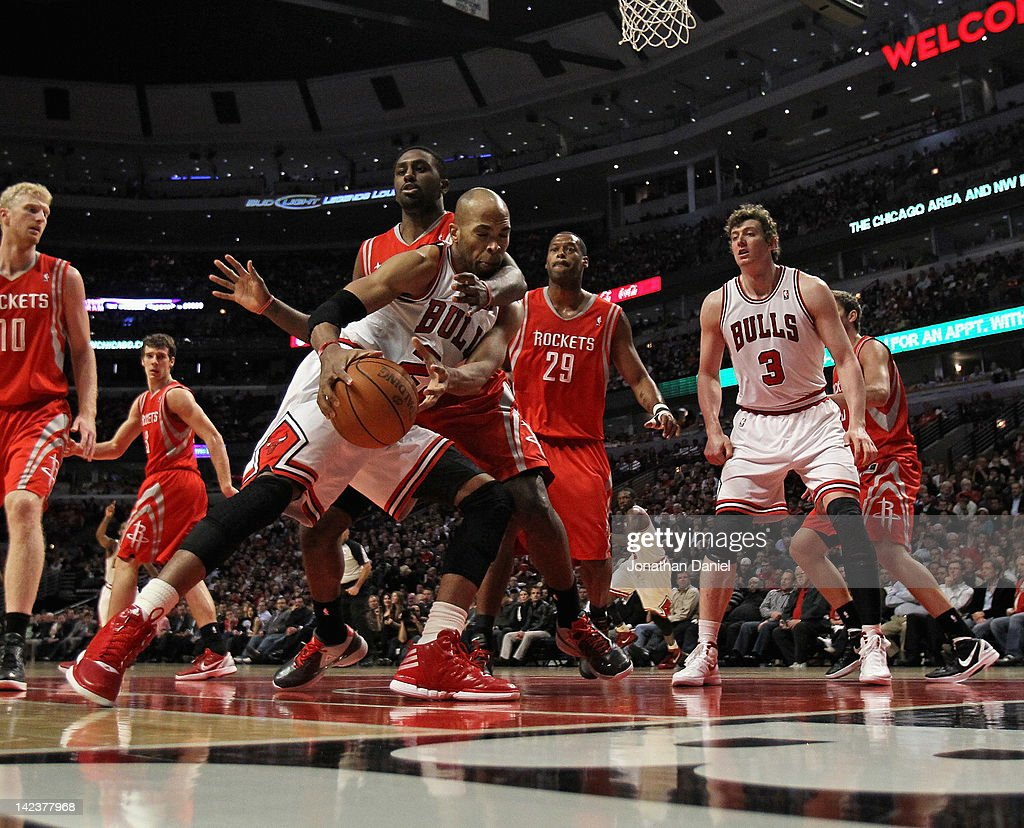 Taj Gibson #22 of the Chicago Bulls tries to shoot against patirck Patterson #54 of the Houston Rockets as Marcus Camby #29 and Omer Asik #3 watch at the United Center on April 2, 2012 in Chicago, Illinois. The Rockets defeated the Bulls 99-93.