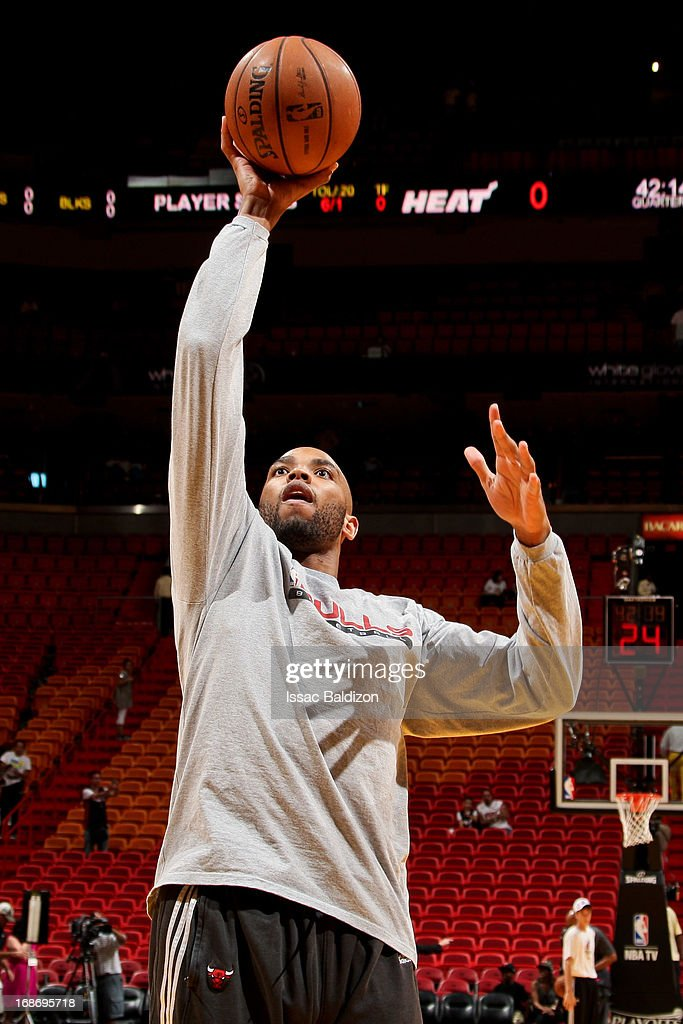 <a gi-track='captionPersonalityLinkClicked' href=/galleries/search?phrase=Taj+Gibson&family=editorial&specificpeople=4029461 ng-click='$event.stopPropagation()'>Taj Gibson</a> #22 of the Chicago Bulls warms up before playing against the Miami Heat in Game Two of the Eastern Conference Semifinals during the 2013 NBA Playoffs on May 8, 2013 at American Airlines Arena in Miami, Florida.