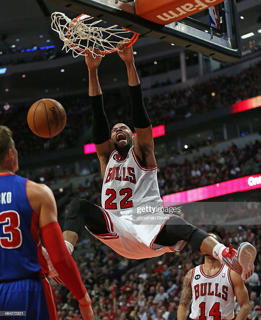Taj Gibson #22 of the Chicago Bulls yells after dunking against the Detroit Pistons at the United Center on April 11, 2014 in Chicago, Illinois. The Bulls defeated the Pistons 106-98.