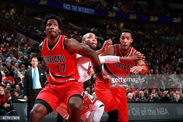 Taj Gibson of the Chicago Bullsl fights for the position against Ed Davis and Evan Turner of the Portland Trail Blazers on December 5 2016 at the...