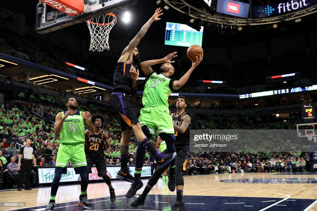 Taj Gibson #67 of the Minnesota Timberwolves goes to the basket against the Phoenix Suns on December 16, 2017 at Target Center in Minneapolis, Minnesota.