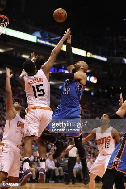 Taj Gibson of the Oklahoma City Thunder attempts a shot over Alan Williams of the Phoenix Suns during the first half of the NBA game at Talking Stick...