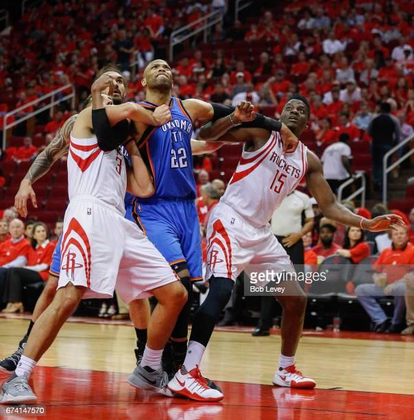 Taj Gibson of the Oklahoma City Thunder battles with Ryan Anderson of the Houston Rockets and Clint Cappella of the Houston Rockets for a rebound...