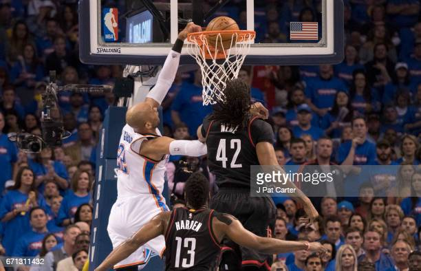 Taj Gibson of the Oklahoma City Thunder goes over Nene Hilario of the Houston Rockets for two points during the first half of Game Three in the 2017...