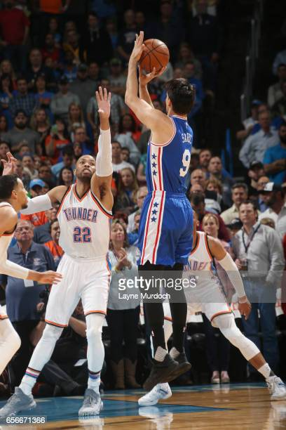 Taj Gibson of the Oklahoma City Thunder plays defense against Dario Saric of the Philadelphia 76ers during the game on March 22 2017 at Chesapeake...