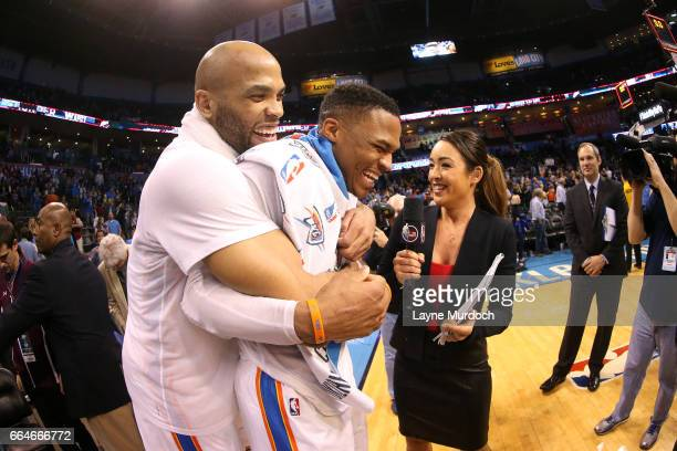 Taj Gibson shares a hug with Russell Westbrook of the Oklahoma City Thunder after the game against the Milwaukee Bucks on April 4 2017 at Chesapeake...