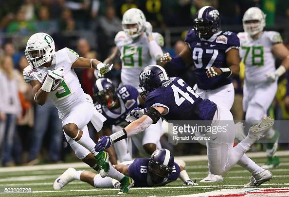 Taj Griffin of the Oregon Ducks runs the ball against the TCU Horned Frogs in the first quarter during the Valero Alamo Bowl at Alamodome on January...