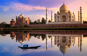 Taj Mahal is a white marble mausoleum on the banks of the Yamuna river built by Mughal Emperor Shah Jahan. A UNESCO World Heritage site at Agra, India. Photograph taken from Mehtab Bagh.