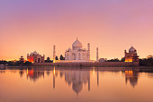 Taj Mahal reflecting in a river on sunset, Agra, India