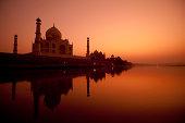 """Taj Mahal in sunset view, water reflection of yamuna river"""