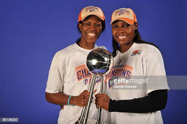 Taj McWilliamsFranklin and Cheryl Ford of the Detroit Shock poses for a portrait after winning Game Three of the WNBA Finals against the San Antonio...