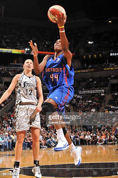 Taj McWilliamsFranklin of the Detroit Shock shoots against Ann Wauters of the San Antonio Silver Stars in Game Two of the WNBA Finals on October 3...