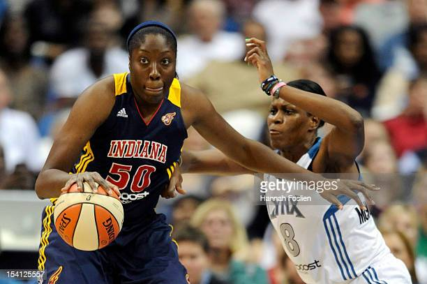 Taj McWilliamsFranklin of the Minnesota Lynx defends against Jessica Davenport of the Indiana Fever during the second quarter in Game One of the 2012...