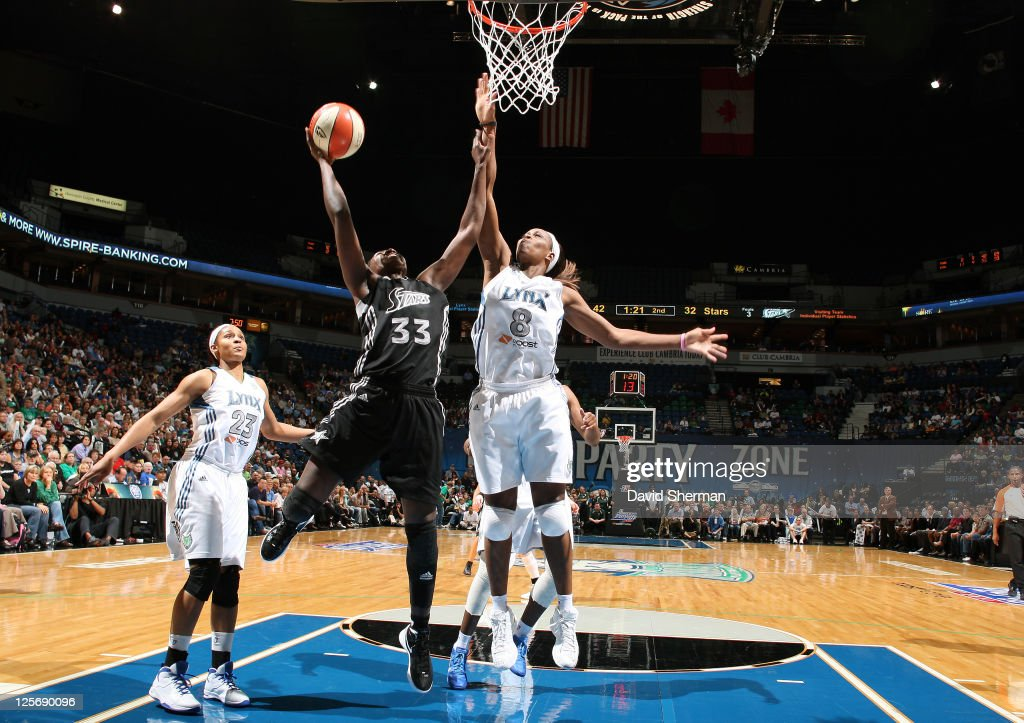 <a gi-track='captionPersonalityLinkClicked' href=/galleries/search?phrase=Taj+McWilliams-Franklin&family=editorial&specificpeople=213186 ng-click='$event.stopPropagation()'>Taj McWilliams-Franklin</a> #8 of the Minnesota Lynx goes for the block against <a gi-track='captionPersonalityLinkClicked' href=/galleries/search?phrase=Sophia+Young&family=editorial&specificpeople=541422 ng-click='$event.stopPropagation()'>Sophia Young</a> #33 of the San Antonio Silver Stars in Game Three of the Western Conference Semifinals during the 2011 WNBA Playoffs on September 20, 2011 at Target Center in Minneapolis, Minnesota.
