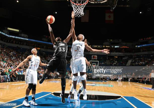 Taj McWilliamsFranklin of the Minnesota Lynx goes for the block against Sophia Young of the San Antonio Silver Stars in Game Three of the Western...