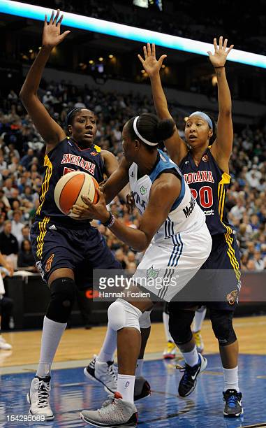 Taj McWilliamsFranklin of the Minnesota Lynx looks to pass around Jessica Davenport and Briann January of the Indiana Fever during the second quarter...
