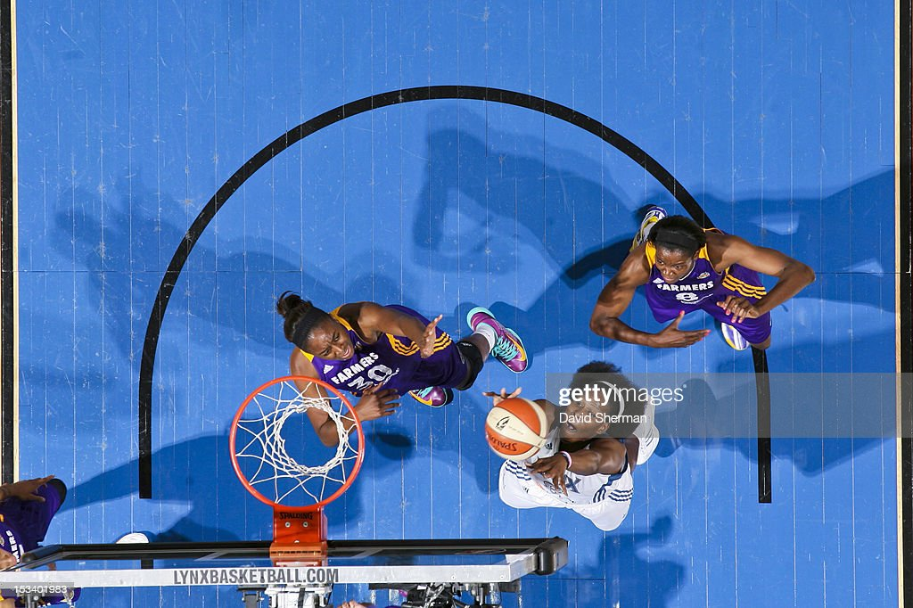 Taj McWilliams-Franklin #8 of the Minnesota Lynx shoots against Nneka Ogwumike #30 of the Los Angeles Sparks during Game One of the 2012 WNBA Western Conference Finals on October 4, 2012 at Target Center in Minneapolis, Minnesota.