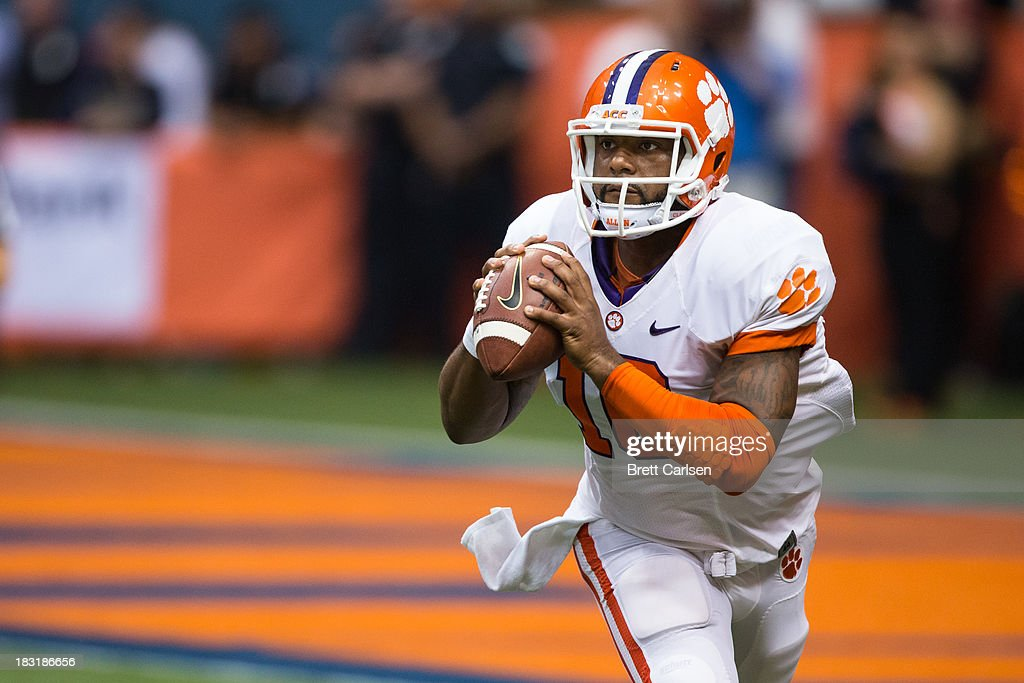<a gi-track='captionPersonalityLinkClicked' href=/galleries/search?phrase=Tajh+Boyd&family=editorial&specificpeople=7352415 ng-click='$event.stopPropagation()'>Tajh Boyd</a> #10 of Clemson Tigers lines up a first down reception in the first quarter against Syracuse Orange on October 5, 2013 at the Carrier Dome in Syracuse, New York. Clemson defeated Syracuse 49-14.
