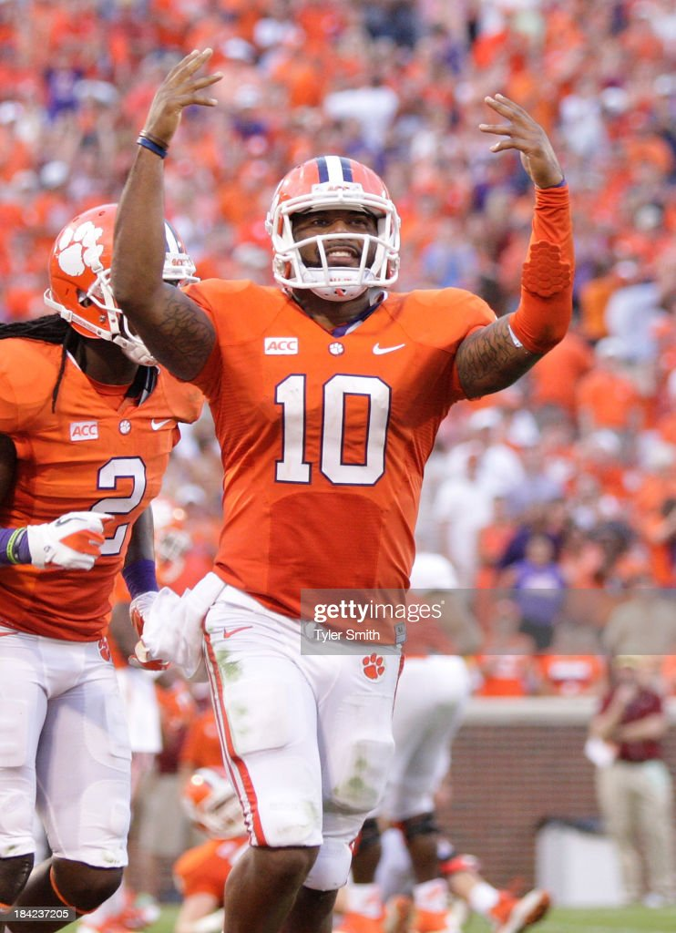<a gi-track='captionPersonalityLinkClicked' href=/galleries/search?phrase=Tajh+Boyd&family=editorial&specificpeople=7352415 ng-click='$event.stopPropagation()'>Tajh Boyd</a> #10 of the Clemson Tigers celebrates after scoring a touchdown against the Boston College Eagles at Memorial Stadium on October 12, 2013 in Clemson, South Carolina.