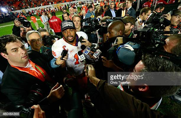 Tajh Boyd of the Clemson Tigers is interviewed by the media after defeating the Ohio State Buckeyes during the Discover Orange Bowl at Sun Life...