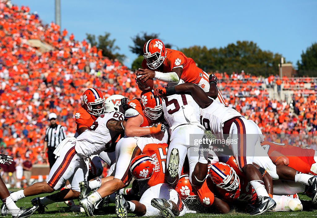 <a gi-track='captionPersonalityLinkClicked' href=/galleries/search?phrase=Tajh+Boyd&family=editorial&specificpeople=7352415 ng-click='$event.stopPropagation()'>Tajh Boyd</a> #10 of the Clemson Tigers is stopped short as he dives for a touchdown against the Virginia Tech Hokies during their game at Clemson Memorial Stadium on October 20, 2012 in Clemson, South Carolina.