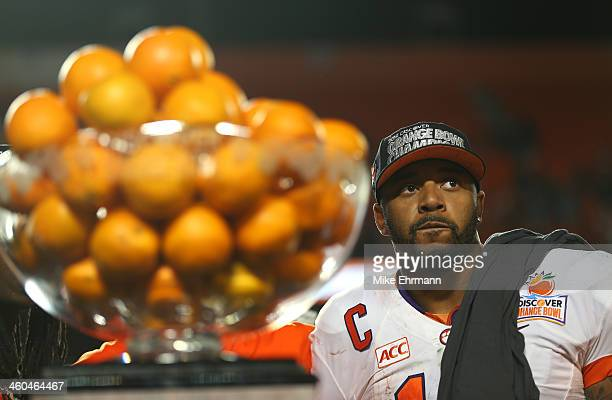 Tajh Boyd of the Clemson Tigers looks on from the trophy podium after defeating the Ohio State Buckeyes during the Discover Orange Bowl at Sun Life...