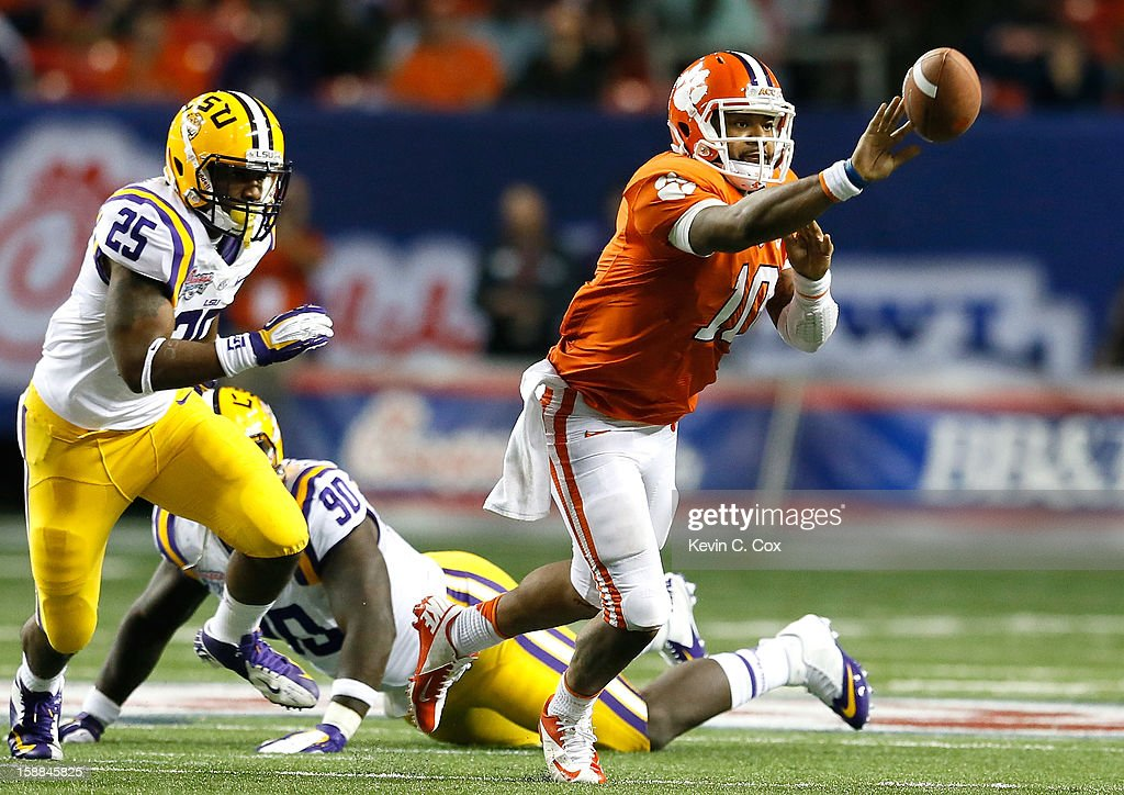 Tajh Boyd #10 of the Clemson Tigers pitches the ball away from Kwon Alexander #25 of the LSU Tigers during the 2012 Chick-fil-A Bowl at Georgia Dome on December 31, 2012 in Atlanta, Georgia.